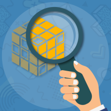 Icon showing hand holding magnifying glass examining block representing business model